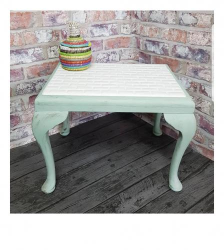 The tiled footstool